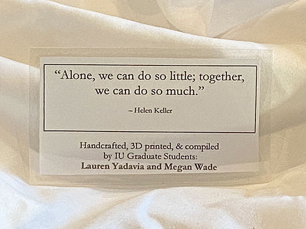 "An image of the laminated message attached to the PPE the students distribute. The message reads, ""Alone, we do so little; together, we can do so much."" ~ Helen Keller"